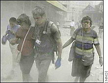 People walk away from the World Trade Center as ash rains down - CNN